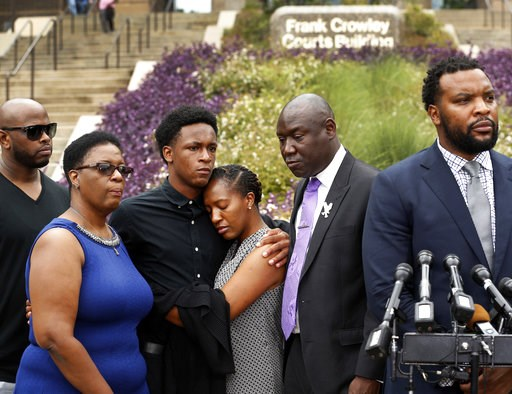 (Tom Fox/The Dallas Morning News via AP). Brandt Jean, center left, brother of shooting victim Botham Jean, hugs his sister Allisa Charles-Findley, during a news conference outside the Frank Crowley Courts Building on Monday, Sept. 10, 2018, in Dallas,...
