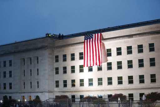 (AP Photo/Pablo Martinez Monsivais). A U.S. flag is unfurled at sunrise on Tuesday, Sept. 11, 2018, at the Pentagon on the 17th anniversary of the Sept. 11, 2001, terrorist attacks.