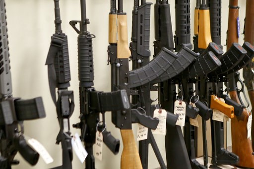 (AP Photo/Keith Srakocic). FILE - This March 1, 2018 file photo shows a display of various models of semi-automatic rifles at a store in Pennsylvania. Research published Tuesday, Sept. 11, 2018 in the Journal of the American Medical Association shows a...