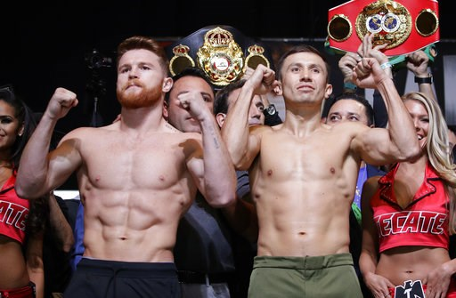 (AP Photo/John Locher, File). FILE - In this Sept. 15, 2017, file photo, Canelo Alvarez, left, and Gennady Golovkin pose during a weigh-in in Las Vegas. Golovkin's trainer says his fighter was insulted when Alvarez tested positive for a performance enh...