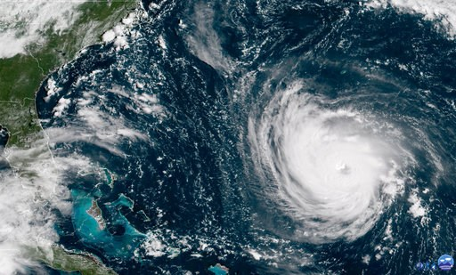 (NOAA via AP). This GOES East satellite image taken Tuesday, Sept. 11, 2018, at 10:30 a.m. EDT, and provided by NOAA shows Hurricane Florence in the Atlantic Ocean as it threatens the U.S. East Coast, including Florida, Georgia, South and North Carolin...