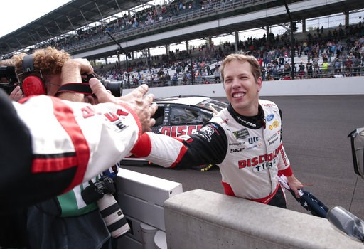 (AP Photo/AJ Mast). Brad Keselowski celebrates after winning the NASCAR Brickyard 400 auto race at Indianapolis Motor Speedway in Indianapolis, Monday, Sept. 10, 2018.