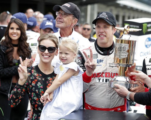 (AP Photo/Michael Conroy). NASCAR Cup Series driver Brad Keselowski (2) celebrates with his wife Paige and daughter Scarlett after winning the NASCAR Brickyard 400 auto race at Indianapolis Motor Speedway, in Indianapolis Monday, Sept. 10, 2018.