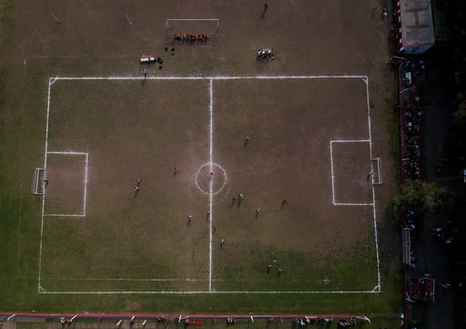(AP Photo/Natacha Pisarenko). In this Sept. 8, 2018 photo, the Huracan de Chabas plays against Alumni, in Chabaz, Argentina. Two months ago, the regional soccer authorities notified Huracan that the team could no longer include Candelaria, a 7-year-old...