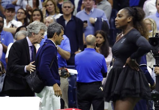 (AP Photo/Julio Cortez). Chair umpire Carlos Ramos, second from left, is lead off the court by referee Brian Earley after Naomi Osaka, of Japan, defeated Serena Williams in the women's final of the U.S. Open tennis tournament, Saturday, Sept. 8, 2018, ...