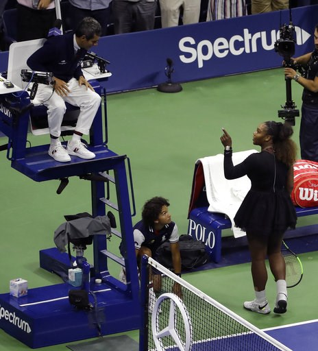 (AP Photo/Seth Wenig). Serena Williams talks with chair umpire Carlos Ramos after being defeated by Naomi Osaka, of Japan, in the women's final of the U.S. Open tennis tournament, Saturday, Sept. 8, 2018, in New York.