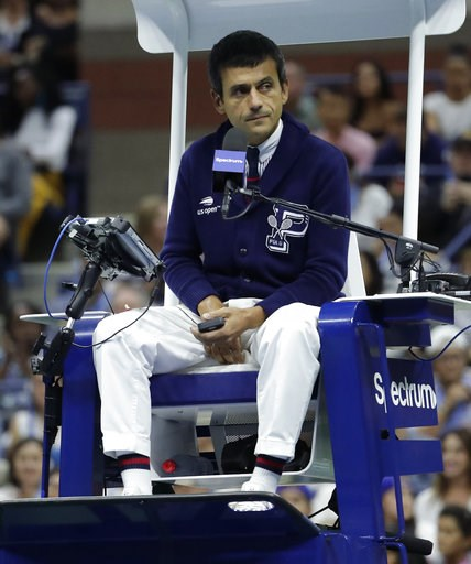 (AP Photo/Julio Cortez). Chair umpire Carlos Ramos watches play as he officiates the match between Serena Williams and Naomi Osaka, of Japan, during the women's final of the U.S. Open tennis tournament, Saturday, Sept. 8, 2018, in New York.