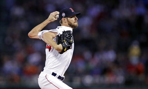 (AP Photo/Charles Krupa). Boston Red Sox starting pitcher Chris Sale delivers during the first inning of a baseball game against the Toronto Blue Jays at Fenway Park in Boston, Tuesday, Sept. 11, 2018.