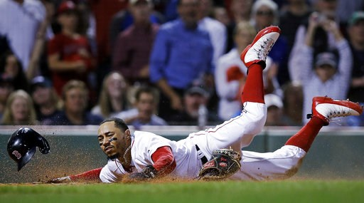 (AP Photo/Charles Krupa). Boston Red Sox's Mookie Betts scores on a double by Andrew Benintendi during the eighth inning of a baseball game against the Toronto Blue Jays at Fenway Park in Boston, Tuesday, Sept. 11, 2018.