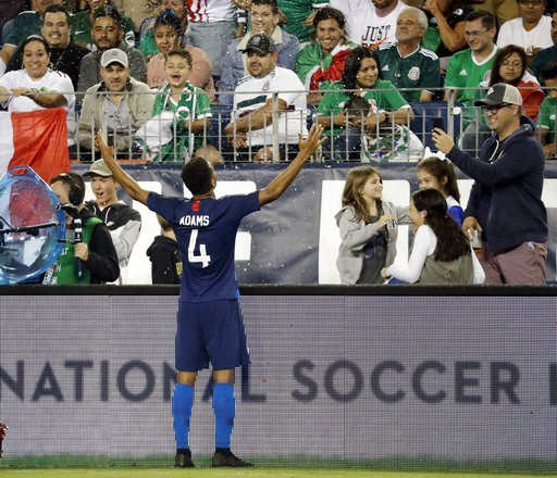 (AP Photo/Mark Humphrey). United States midfielder Tyler Adams (4) celebrates after scoring a goal against Mexico during an international friendly match Tuesday, Sept. 11, 2018, in Nashville, Tenn. The United States won 1-0.