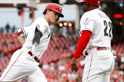 (AP Photo/John Minchillo). Cincinnati Reds' Brandon Dixon, left, celebrates with third base coach Billy Hatcher (22) after hitting a solo home run off Los Angeles Dodgers starting pitcher Hyun-Jin Ryu in the second inning of a baseball game, Tuesday, S...
