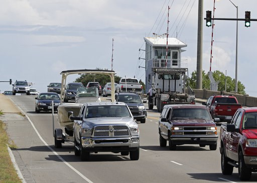 (AP Photo/Chuck Burton). People drive over a drawbridge in Wrightsville Beach, N.C., as they evacuate the area in advance of Hurricane Florence, Tuesday, Sept. 11, 2018. Florence exploded into a potentially catastrophic hurricane Monday as it closed in...