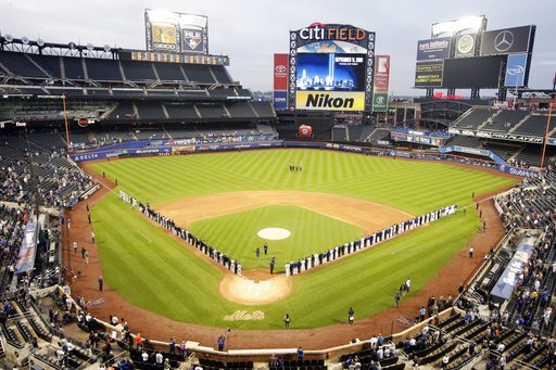 (AP Photo/Frank Franklin II). The Miami Marlins and the New York Mets joins members of the New York police and fire departments on the field for pregame ceremonies before a baseball game Tuesday, Sept. 11, 2018, in New York.