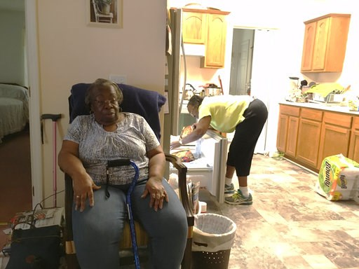 (AP Photo/Emery P. Dalesio). Dorothy Pope, 78, and her sister Clydie Gardner, 71, settle in to the home they share in Princeville, N.C., after a normal grocery run on Tuesday, Sept. 11, 2018. They are keeping an eye on the storm but have no plans to le...
