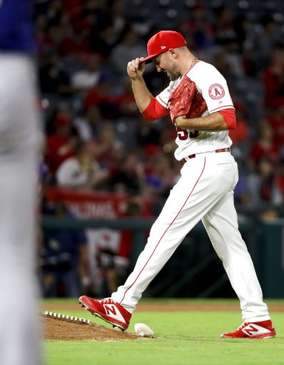 (AP Photo/Chris Carlson). Los Angeles Angels relief pitcher Blake Parker reacts after giving up the first hit of the game to the Texas Rangers during the eighth inning of a baseball game in Anaheim, Calif., Tuesday, Sept. 11, 2018.