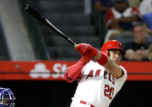 (AP Photo/Chris Carlson). Los Angeles Angels' Jose Fernandez watches his home run against the Texas Rangers during the second inning of a baseball game in Anaheim, Calif., Tuesday, Sept. 11, 2018.