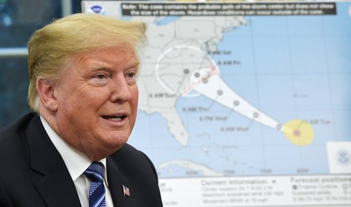 (AP Photo/Susan Walsh). President Donald Trump talks about Hurricane Florence following a briefing in the Oval Office of the White House in Washington, Tuesday, Sept. 11, 2018.
