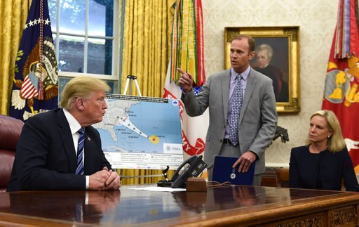 (AP Photo/Susan Walsh). President Donald Trump, left, listens as FEMA Administrator Brock Long, center, talks about Hurricane Florence in the Oval Office of the White House in Washington, Tuesday, Sept. 11, 2018. Homeland Security Secretary Kirstjen Ni...
