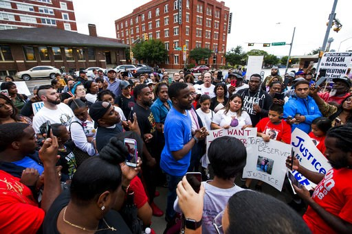 (Shaban Athuman /The Dallas Morning News via AP). Protesters in the shooting death of Botham Jean, gather at the Jack Evans Police Headquarters, Monday, Sept. 10, 2018 in Dallas. Jean was shot Thursday by off-duty Dallas police officer Amber Guyger, wh...