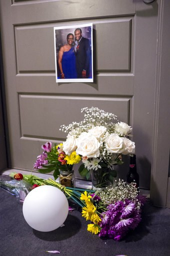 (Shaban Athuman /The Dallas Morning News via AP). Flowers are placed at the front door of Botham Jean's apartment on Monday, Sept. 10, 2018 in Dallas. Jean was shot Thursday by off-duty Dallas police officer Amber Guyger, who says she mistook his apart...