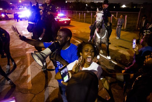 (Shaban Athuman /The Dallas Morning News via AP). Dominique Alexander speaks to the protesters of the shooting of Botham Jean on Monday, Sept. 10, 2018 at the Jack Evans Police Headquarters in Dallas. Jean was shot Thursday by off-duty Dallas police of...