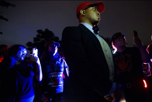 (Shaban Athuman /The Dallas Morning News via AP). Jamil Tucker listen to Dominique Alexander as they march down to the Dallas Police Association Office to protest the shooting of Botham Jean on Monday, Sept. 10, 2018 in Dallas.  Jean was shot Thursday ...