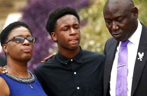 (Tom Fox/The Dallas Morning News via AP). Brandt Jean, center, brother of Botham Jean, cries as he attends a news conference outside the Frank Crowley Courts Building on Monday, Sept. 10, 2018, in Dallas, about the shooting of Botham Jean by Dallas pol...