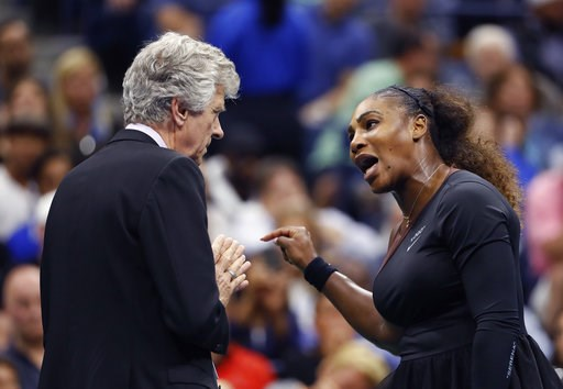 (AP Photo/Adam Hunger, File). FILE - In this Saturday, Sept. 8, 2018, file photo, Serena Williams, right, talks with referee Brian Earley during the women's final of the U.S. Open tennis tournament against Naomi Osaka, of Japan, in New York. Some black...