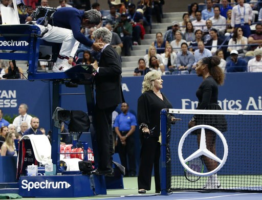 (AP Photo/Andres Kudacki). Chair umpire Carlos Ramos, left, talks with referee Brian Earley as Serena Williams talks with Donna Kelso during the women's final of the U.S. Open tennis tournament against Naomi Osaka, of Japan, Saturday, Sept. 8, 2018, in...