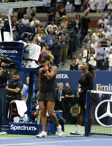 (AP Photo/Andres Kudacki). Naomi Osaka, of Japan, reacts as Serena Williams talks with chair umpire Carlos Ramos after Osaka defeated Williams in the women's final of the U.S. Open tennis tournament, Saturday, Sept. 8, 2018, in New York.