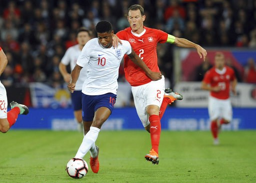 (AP Photo/ Rui Vieira). England's Marcus Rashford, left, and Switzerland's Stephan Lichtsteiner challenge for the ball during the International friendly soccer match between England and Switzerland at the King Power Stadium in Leicester, England, Tuesd...