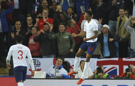 (AP Photo/ Rui Vieira). England's Marcus Rashford celebrates after scoring his side's first goal during the International friendly soccer match between England and Switzerland at the King Power Stadium in Leicester, England, Tuesday, Sept. 11, 2018 .