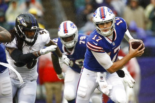 (AP Photo/Patrick Semansky). Buffalo Bills quarterback Josh Allen (17) scrambles away from Baltimore Ravens linebacker Tim Williams (56) with the ball during the second half of an NFL football game, Sunday, Sept. 9, 2018, in Baltimore.