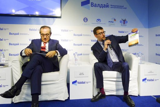 (valdaiclub.com via AP). In this handout photo taken on April 19, 2016, released by Valdai Club foundation, shows Ivan Timofeev, right, and Joseph Mifsud, attend the Valdai Discussion Club Conference following the results of the closed-door Iran-Russia...