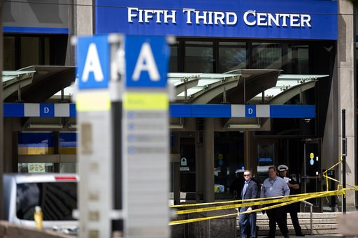 (Albert Cesare/The Cincinnati Enquirer via AP, File). FILE - In this Sept. 6, 2018 file photo, police investigate outside Fifth Third Bank building on Fountain Square after a shooting with multiple fatalities in downtown Cincinnati. The two shooting vi...