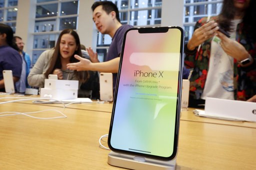 (AP Photo/Richard Drew, File). FILE - In this Nov. 3, 2017, file photo, customers buy the iPhone X at the Apple Store on New York's Fifth Avenue. Apple is expected to unveil its biggest and most expensive iPhone on Wednesday, Sept. 12, 2018, as part of...
