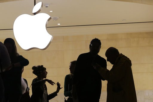 (AP Photo/Mark Lennihan, File). FILE- In this May 31, 2018, file photo customers enter the Apple store in New York. Apple is expected to unveil its biggest and most expensive iPhone yet on Wednesday, Sept. 12, along with two smaller, cheaper versions i...