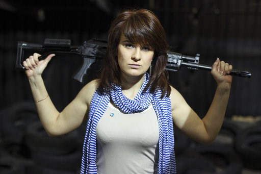 (AP Photo/Pavel Ptitsin, File). FILE - In this Sunday, April 22, 2012 filer, Maria Butina, a gun-rights activist, poses for a photo at a shooting range in Moscow, Russia. Accused of working as an undeclared foreign agent in the U.S., Butina is fast bec...