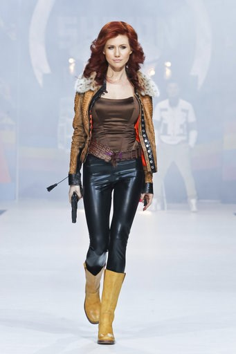 (AP Photo /Luba Sheme, File). FILE. In this file photo taken on Sunday, April 3, 2011, Anna Chapman, who was deported from the U.S. on charges of espionage, displays a creation by Russian designers Shiyan & Rudkovskaya during a Fashion Week in Mosc...