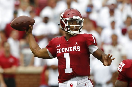 (AP Photo/Sue Ogrocki, File). FILE - In this Saturday, Sept. 8, 2018, file photo, Oklahoma quarterback Kyler Murray (1) throws during an NCAA college football game against UCLA, in Norman, Okla. The pressure on Murray just increased now that running ba...