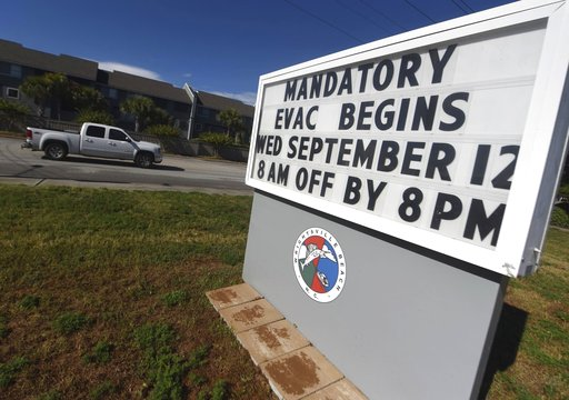 (Matt Born/The Star-News via AP). A sign warns residents about the mandatory evacuation in front of Wrightsville Beach Park in Wrightsville Beach, N.C., Wednesday, Sept. 12, 2018. The effects of Hurricane Florence in Southeastern North Carolina are exp...