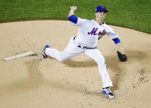 (AP Photo/Frank Franklin II). New York Mets' Jacob deGrom delivers a pitch during the first inning of a baseball game against the Miami Marlins Tuesday, Sept. 11, 2018, in New York.