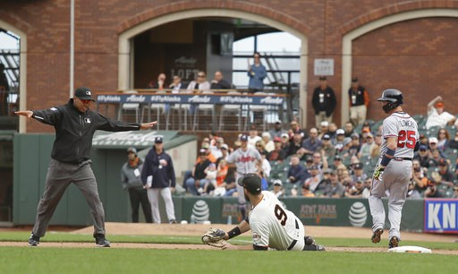 (AP Photo/Eric Risberg). Atlanta Braves' Tyler Flowers makes it safely to first base as San Francisco Giants first baseman Brandon Belt (9) looks for the ruling from umpire Jeremie Rehak during the ninth inning of a baseball game Wednesday, Sept. 12, 2...