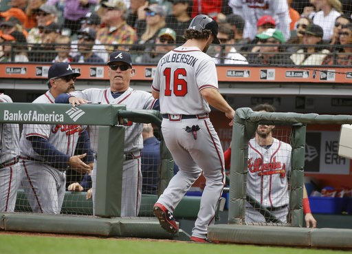 (AP Photo/Eric Risberg). Atlanta Braves' Charlie Culberson (16) is greeted by manager Brian Snitker, second from left, after scoring the Braves' second run in the ninth inning of a baseball game against the San Francisco Giants Wednesday, Sept. 12, 201...