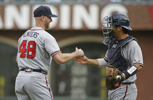 (AP Photo/Eric Risberg). Atlanta Braves relief pitcher Jonny Venters is greeted by catcher Kurt Suzuki at the end of a baseball game against the San Francisco Giants Wednesday, Sept. 12, 2018, in San Francisco. Atlanta won the game 2-1.
