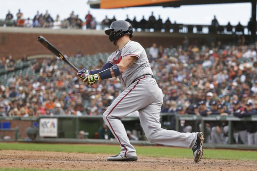 (AP Photo/Eric Risberg). Atlanta Braves' Tyler Flowers hits an RBI single off San Francisco Giants relief pitcher Will Smith in the ninth inning of a baseball game Wednesday, Sept. 12, 2018, in San Francisco.
