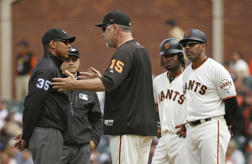 (AP Photo/Eric Risberg). San Francisco Giants manager Bruce Bochy argues with first base umpire Jeremie Rehab after Alen Hanson, second from right, was called out at first base on a sacrifice in the seventh inning of a baseball game against the Atlanta...
