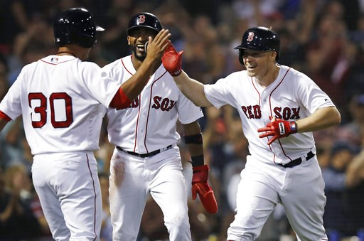 (AP Photo/Charles Krupa). Boston Red Sox's Brock Holt, right, celebrates with Tzu-Wei Lin (30) and Eduardo Nunez, center, after his pinch-hit, three-run home run off Toronto Blue Jays relief pitcher Ryan Tepera during the seventh inning of a baseball g...