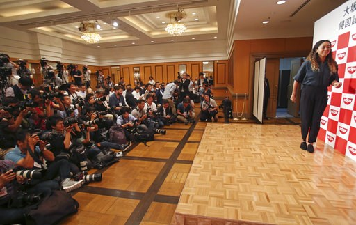 (AP Photo/Koji Sasahara). Naomi Osaka,  the champion of U.S. Open women's singles, arrives for a press conference in Yokohama, Thursday, Sept. 13, 2018. Osaka defeated Serena Williams of the U.S. on Saturday, Sept. 8, to become the first Grand Slam sin...
