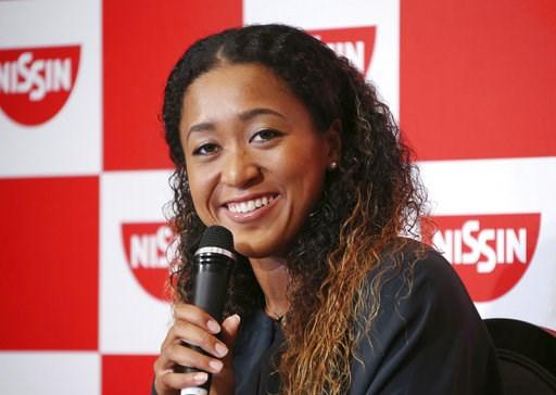 (AP Photo/Koji Sasahara). Naomi Osaka,  the champion of U.S. Open women's singles,  smiles during a press conference in Yokohama , Thursday, Sept. 13, 2018. Osaka defeated Serena Williams of the U.S. on Saturday, Sept. 8, to become the first Grand Slam...